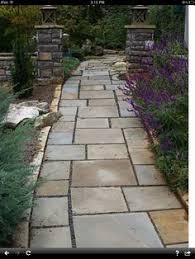 Backyard Walkway Ideas by Wide Natural Stone Walkway Splitting Into Two Smaller Walkways