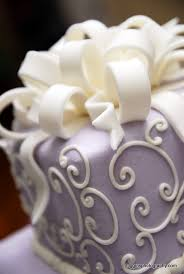 cake ribbon file lavender wedding cake with white swirls and ribbon as