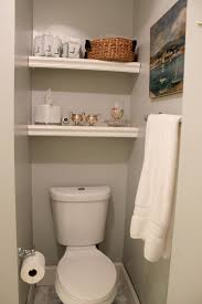 built in shelving over toilet bathroom made of wooden in white