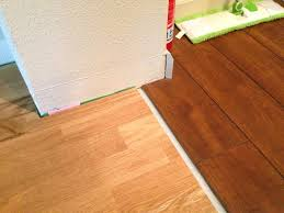 how to install baseboard at the transition between floors with