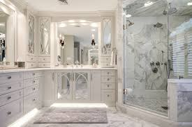 this master bathroom features gorgeous white calacatta marble tile