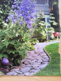 rock border between grass and flower bed le jardin pinterest