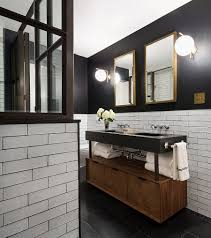Black Vanity Farmhouse Style Bathroom With Stone Wall And Twin Black Vanities
