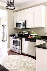 white oak wood black shaker door upper kitchen cabinet height
