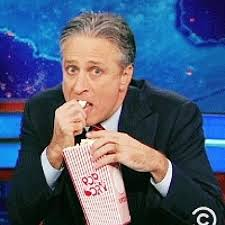 Meme Eating Popcorn - jon stewart eagerly watching eating his popcorn on the daily show