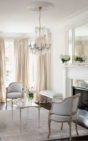 best 20 silk curtains ideas on pinterest french curtains pale neutral formal sitting room with silver accents an oversized triptych mirror crystal chandelier and dramatic floor to ceiling cream silk curtains