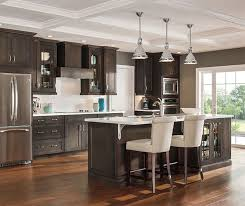 colors for a kitchen with dark cabinets dark kitchen cabinets wall color white gloss island with black