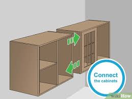 how to hang a cabinet to the wall how to hang wall cabinets 15 steps with pictures wikihow