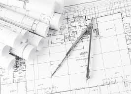 rolls of architecture blueprints and house plans signs unlimited