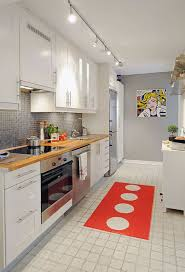 galley style in small apartment kitchen storage with portrait wall