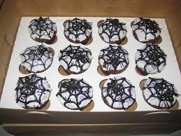 file a dozen spiderweb cupcakes white frosting and black