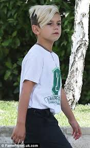 skater haircut for boys gwen stefani sweetly carries kingston s shoes as he walks barefoot
