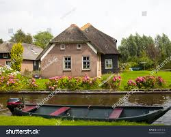 Giethoorn Homes For Sale by Old Traditional Dutch House Giethoorn Stock Photo 83997316