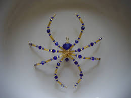 blue and gold glass beaded christmas spider german legend of