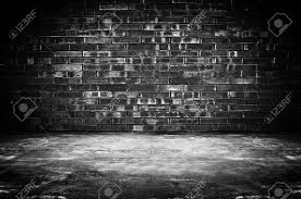 old dark room with brick wall and concrete floor as background