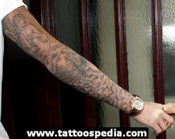 jesus cross n rosary tattoo on forearm photos pictures and