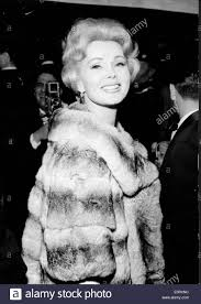actress zsa zsa gabor arrives at an event in fur coat stock photo