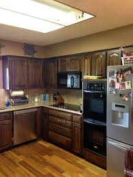 how to paint brown cabinets using chalk paint to refinish kitchen cabinets wilker do s