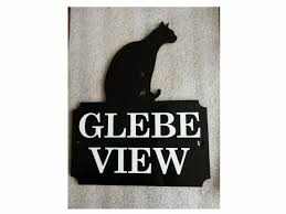 steel house name plate with cat design