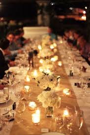 candle runners simple table decor flowers in clear vases surrounded by