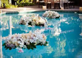 elegant backyard decoration with floating wedding flowers candles