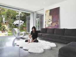 rugs interesting white faux sheepskin rug with black sofa and