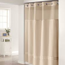 chic hokkless extra long shower curtain liner in tan with straight silver iron on white wall