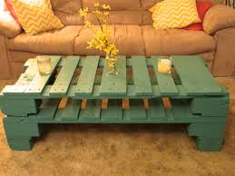 yellow rustic coffee table centerpiece on small mason jar for