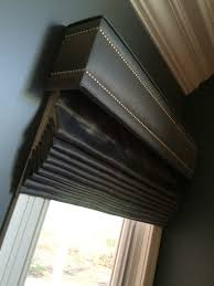 shaped cornice with nailhead details www drapery design com