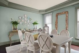 tidy and neat home with white wooden dining chairs dining chairs