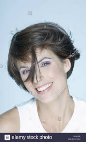 woman with short hair woman with short hair strand of hair in front of face smiling