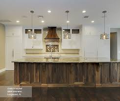 what color countertops with walnut cabinets white cabinets with a walnut kitchen island masterbrand