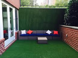 How To Design A Patio Area This Homeowner Had Synlawn Transform Their Concrete Patio Area