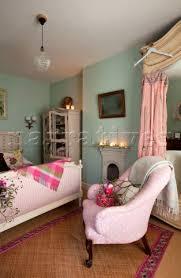 Armchair In Bedroom Pe086 73 Pink Spotted Armchair In Green Pastel Bedroo