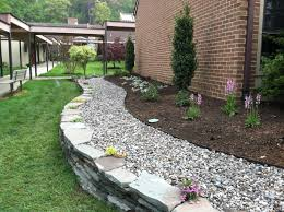 innovative garden design of a small property river rock