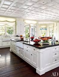 white kitchen cabinets with farm sink 19 inspiring farmhouse kitchen sink ideas architectural digest