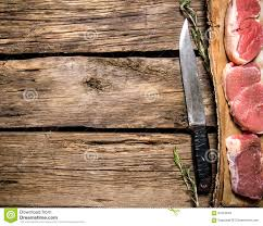 pieces of raw meat with a butcher knife stock photo image 64524046