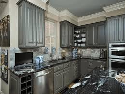 grey kitchen cabinets with granite countertops black granite countertop cream wall painting white frame window dark