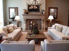 living room with fireplace and tv on opposite walls projects to