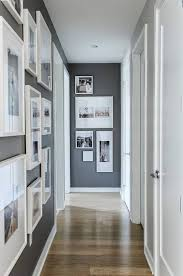 hallway decorating ideas to be applied at your beautiful houses grey wall paint for frames different size as hallway decorating ideas with nice wooden floor