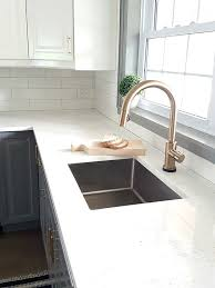 faucet kitchen sink fixing my design mistake with a gold kitchen faucet by delta the