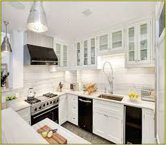 pictures of kitchens with black appliances white kitchen cabinets with black stainless steel appliances