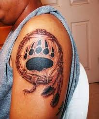 black and white native american dream catcher with bear paw print