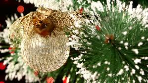 christmas decoration a round shiny gold toy on christmas tree