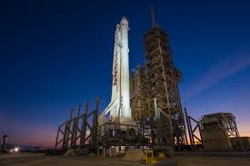 falcon 9 rocket with dragon spacecraft vertical at launch complex