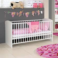 bedroom long crib size on nice floortile pattern and calm wall