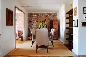 Brick Accent Walls Dining Room Traditional With Yellow Flowers - Dining room accent wall