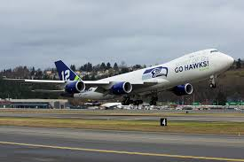 photos boeing paints 747 8 freighter in seahawks colors