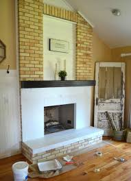 same painted brick fireplace makeover paint brick fireplace before