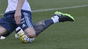 Lionel Messi Leg Ta Two Messi Covers Up Leg Ink Goal Com